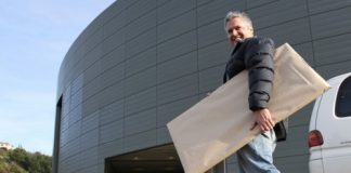 Nic Foster carries artwork into the Trafalgar Centre for this weekend's Nelson Art Expo. Photo: Andrew Board.