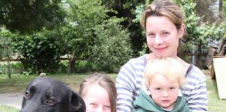 Wakefield's Katie Pearless with her children Tayla, 8, and Lewie, 2, with their remaining dog Baz. Photo: Andrew Board.