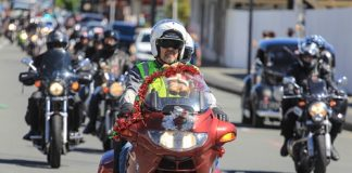 Kyle Neeley leads more than 400 motorcyclists through Queen St during Saturday's Ulysses Nelson Toy Run. Photo: Phillip Rollo.