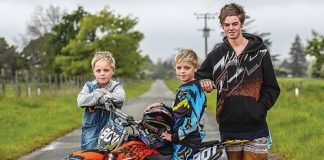 Nine year old Luca Palmer-Donald will be competing at the New Zealand motocross championship on the North Shore this weekend. His twin brother Nico, left, and older brother Jake, 16, will be there supporting him. Photo: Phillip Rollo.