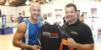 Monty Betham is presented with a Victory Boxing Club hoodie by Paul Hampden when he visited the gym last week. Photo: Andrew Board.