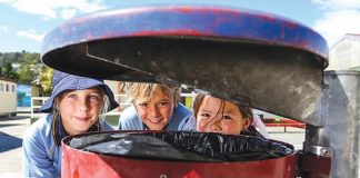 Isabel Lyttle, 9, Brodie Seelen, 10 and Zeeta Anderson, 9, were part of Tahunanui School's Enviro Schools group, which came up with the idea of removing their rubbish bins. Photo: Phillip Rollo.