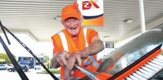 Maurice Abrahams, 94, washes a car window at Z Halifax last Friday as part of a fundraising push by Arthritis New Zealand. Photo: Andrew Board.