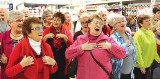Pam Shaw, centre, gets into the music as the over 60s choir Off Their Rockers converged on Fresh Choice Nelson for a much appreciated flash mob. Photo: Jessie Johnston.