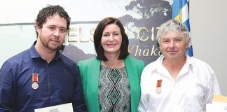 Nelson mayor Rachel Reese with Kyle Paki Paki, left, and Philip Walker after they were awarded the Royal Humane Society Awards for Bravery. Photo: Jessie Johnston.