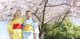 Zara Douglas-Clifford and Nina Usui, both 10, from Japan's Kids Group, under one of Miyazu Gardens' Cherry Blossom Trees. Photo: Jessie Johnston.