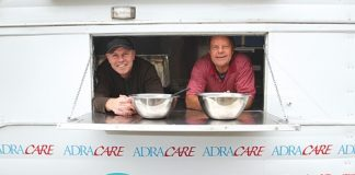 Martin Reading from Food for Families, left, and Abon Wastney from Adra Care, in the caravan that Adra has donated Martin. Photo: Andrew Board.