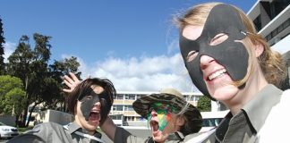 Department of Conservation staff members who will be participating in the masked parade this Friday. They are, from left, KJ Cronin, Winnie Luthje and Petra Bolitho. Photo: Andrew Board.