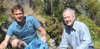 Michael Fox and Malcolm Ross from the Stoke Tahunanui Rotary Club cleaning up the coastline around Monaco. Photo: Jessie Johnston.