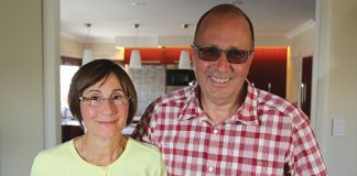 Senior constable Peter Buzzard with his wife Debby, 17 months after a brutal attack on Peter. Photo: Andrew Board.
