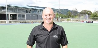 Nelson Hockey's development officer, Craig Brett, on the Saxton Field hockey turf that will host a New Zealand hockey test for the first time in 62 years. Insert left: The cover of the test programme the last time New Zealand played a test in Nelson, against Australia in 1952. Insert right: The New Zealand that played the Nelson test, including Nelson man Fred Gribble [circled]. Photo: Andrew Board.