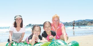 Nelson's Karen Tonkin, Sabrina Tonkin, Jade Tonkin and Leanne Power making the most of the sunshine at Tahunanui Beach. The beach has been a popular place these holidays as sun shines over the region. Photo: Jessie Johnston.