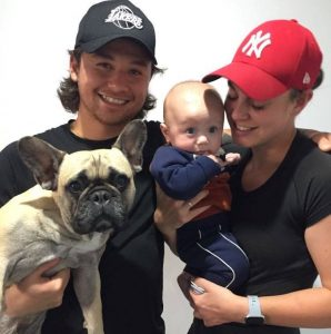 Jordan Yong with his partner Casey Hamson, son Ralph and dog Denzel. Photo: Supplied