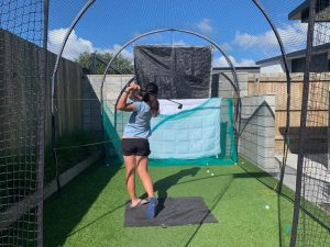 Nelson golfer Lizzie Neale has been making the most of her space at home with a chipping net. Photo: Supplied.