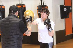 Julie Wotton taking the fight to Victory Boxing's Paul Hampton. Photo: Jonty Dine.